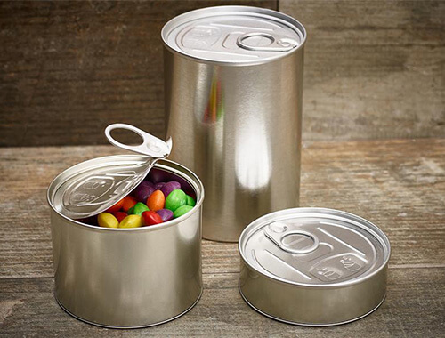 Three cans in different sizes packed with candy