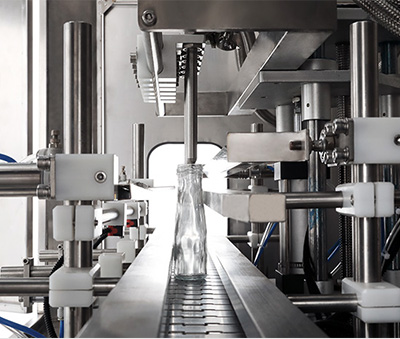 Viscous Liquid Filling Machine filling a glass bottle