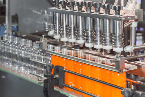 orange juice bottle on factory line machine in the factory