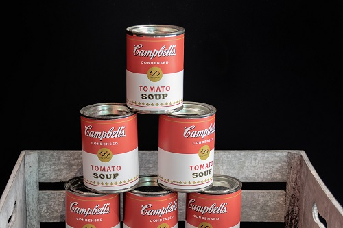 Pile up of Campbell tomato soup cans
