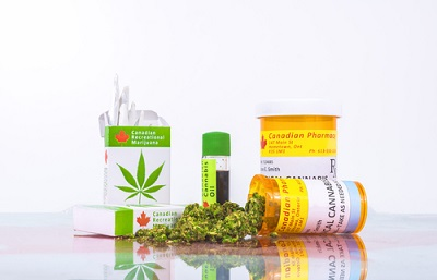 Cannabis in Canada. Marijuana cigarettes, cannabis oil, and prescription bottles for cannabis on a glass table_784182679