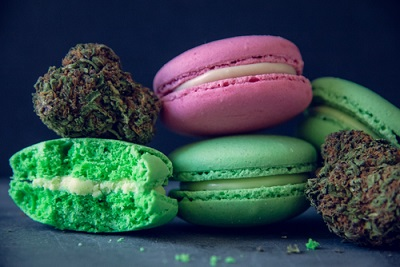 Close Up Marijuana Edibles With Cannabis Nugs On Dark Slate Background