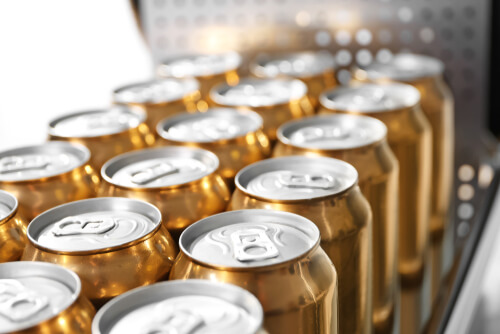 Closeup of cans of beer in brewery