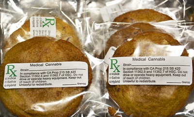 Numerous edible medical marijuana cookies labeled, packaged and stacked for sale at a medical marijuana dispensary in Sun Valley_432665440